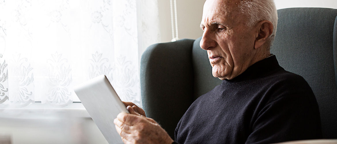 man sitting with tablet